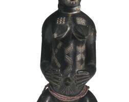 37. baule seated female figure, ivory coast