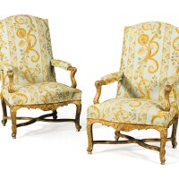 41. a pair of french régence carved giltwood armchairs, circa 1720  