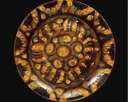 61. a rare abbasid splash ware plate, iran or possibly egypt, circa 8th/9th century