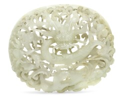 52. a pale celadon reticulated jade 'dragon' plaque ming dynasty, late 15th/16th century