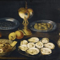 40. attributed to osias beertand studioantwerp circa 1580 - 1623 | still lifewith oysters and olives on tin plates, together with a silver spice box, a nautilus cup and a wan-li bowl with sugared cookies