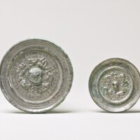 112. two bronze 'dragon' and 'mythical beast' mirrors han dynasty andtang dynasty