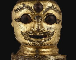 3017. a finely cast gilt-copper repousse mask of bhairava nepal, dated 1545  