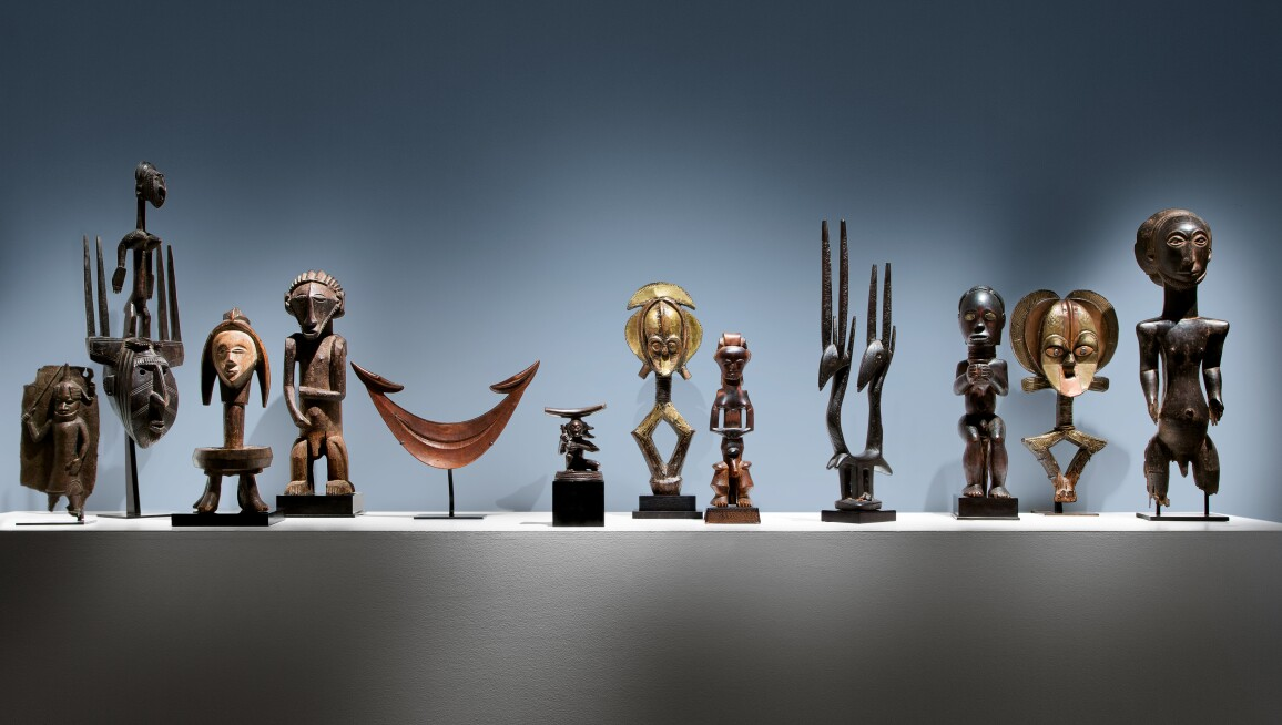 Several works of African and Oceanic Art including sculpted masks, stools, headdresses and effigies