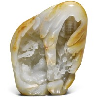 207. a celadon and russet jade mountain