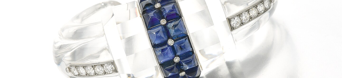 Boucheron rock crystal sapphire diamond bangle jewelry selling at an auction of extravagant jewelry