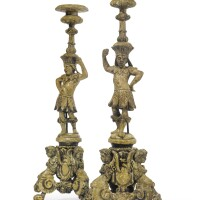41. a pair of italian baroque gray-painted and carved candlesticks 17th century