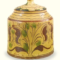 504. rare covered glazed red earthenware jar with sgraffito tulip decoration, possibly by conrad mumbouer (1761-1845) or john monday (1809-1862) haycock township, bucks county, pennsylvania, 1830-1840
