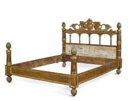 14. an italian faux marble painted and carved wood bed