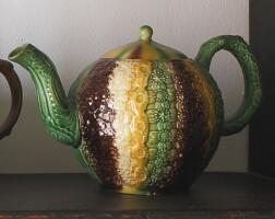 26. staffordshire lead-glazed cream-colored earthenware teapot and a cover circa 1765