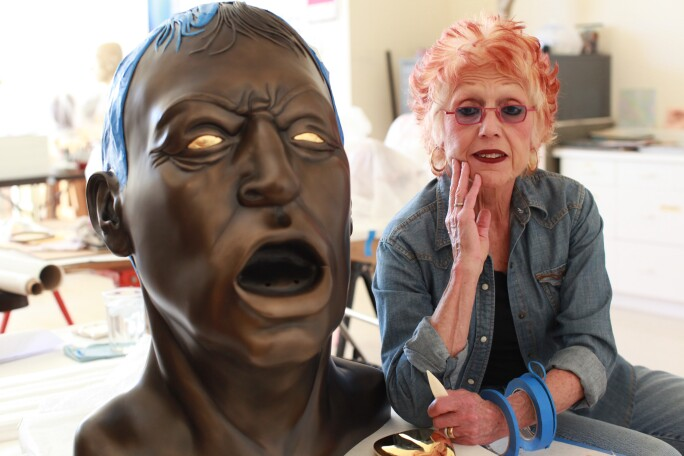 "Artist Judy Chicago Poses With Her Piece Titled ""Grand Bronze Head With Golden Tongue"""