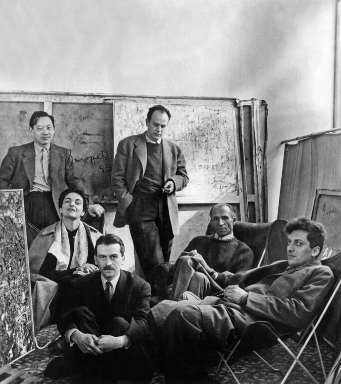 Art dealer Pierre Loeb (seated with pull over) with artists Zao Wou-Ki (behind on l), Maria Elena Vieira da Silva (l), Germain (standing with cigarette), Georges Mathieu (front, on l), Jean Paul Riopelle (front on r) c. 1950