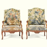 11. a pair of carved walnut and beech fauteuils louis xv, circa 1735