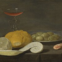 101. jacob van es   still life with a wine glass, peeled lemon, bread roll, olives and shrimps