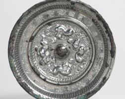 117. a bronze 'mythical beasts' mirror with inscription sui/early tang dynasty