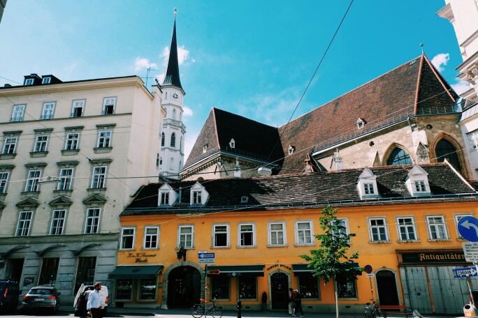 Street View of Vienna on a Sunny Day, Orange, White, and Stone Exteriors of Buildings.