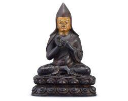 5012. a gilt-lacquered zitan figure of tsongkhapa tibet, 16th – 17th century |