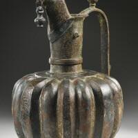 5. a monumental khurasan brass ewer, signed by abu 'ali, afghanistan, 12th century