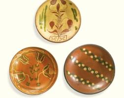 505. rare small sgraffito glazed red earthenware plate with tulip design, philip mumbouer (c. 1750-1834) and nicholas mumbouer (1789-1828) haycock township, bucks county, pennsylvania, 1810-1825