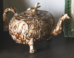 28. staffordshire lead-glazed cream-colored earthenware footed teapot and cover circa1760-65