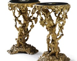 22. a pair of italian pietra dura inlaid black marble topped gilt wooden and plaster guéridon tables 19th century