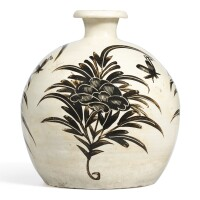 7. a rare cizhou white-ground painted 'peony and butterfly' truncated meiping jindynasty