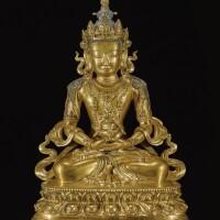 307. a gilt-bronze figure of amitayus qing dynasty, kangxi period |