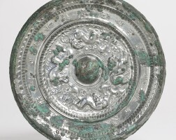 114. a bronze'mythical beasts' mirror with inscription sui/early tang dynasty