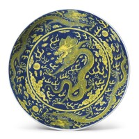 801. an underglaze-blue and yellow-enameled 'dragon' dish qianlong seal mark and period