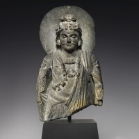 904. a grey schist bust of a bodhisattva ancient region of gandhara, kushan period, 2nd/3rd century  