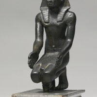 11. an egyptian bronze figure of a king, 30th dynasty/early ptolemaic period, circa 380-250 b.c.