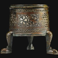 2. a mosul silver and brass-inlaid incense burner base, jazira, 13th century