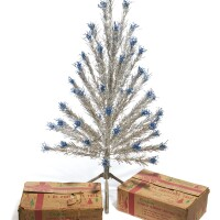 289. two american vintage aluminium and silvered wood christmas trees by 'evergleam', manitowoc, wisconsin, circa 1955-1965