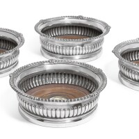 140. a set of fourgeorge iiisilver wine coasters, paul storr of storr & co. for rundell, bridge & rundell, london, 1818 |
