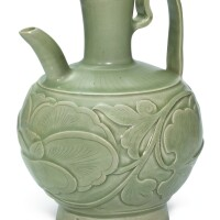 305. a carved yaozhou celadon 'peony' ewer northern song dynasty |