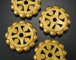 2. pair of colombian gold foil openwork ear ornaments, ca. a.d. 200-400