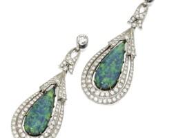 127. pair of platinum, gold, black opal and diamond pendant-earrings, circa 1915
