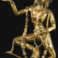 447. a gilt-bronze figure of dakini pukkasi tibet, 15th century
