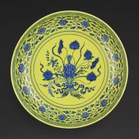 105. a rare underglaze-blue and yellow-enamelled 'lotus bouquet'charger mark and period of yongzheng |