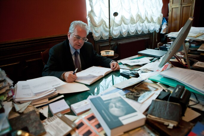 Mikhail Piotrovsky, Director at the Hermitage Museum sits at his desk in St. Petersburg