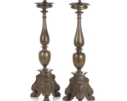 7. a pair of italian bronze candlesticks, possibly rome dated 1619