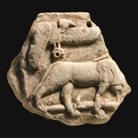 8. an egyptian limestone votive relief fragment, late ptolemaic/early roman period, circa 50 b.c./100 a.d.