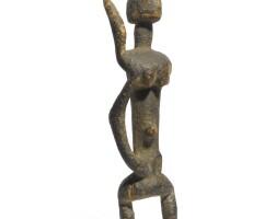 11. a rare dogon four-armed figure, mali