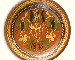 510. rare slipware glazed red earthenware plate with black tulips southeastern pennsylvania, dated 1816
