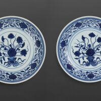 3110. a rare pair of blue and white 'lotus bouquet' dishes seal marks and period of qianlong |
