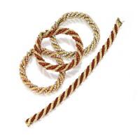 6. group of 18 karat gold and coral bracelets