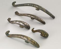 8. five inlaid bronze belt hooks warring states period