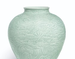 3901. a magnificent carved celadon-glazed 'dragon' jar seal mark and period of qianlong