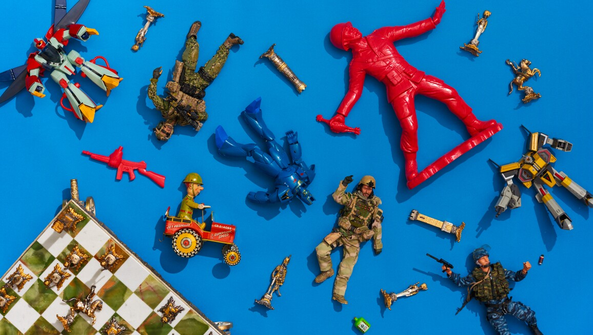 A vignette of Robin William's toys, including toy soldiers and a chess set.