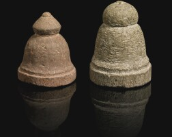 98. two stone gaming pieces, central or south asia, 9th-12th century